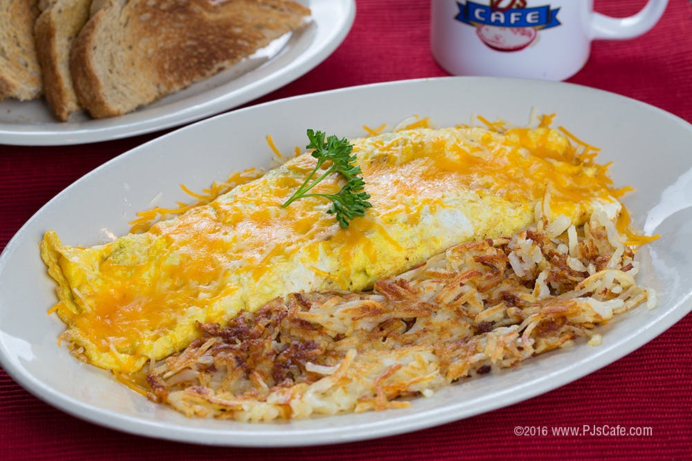 an omelet sitting on a white plate