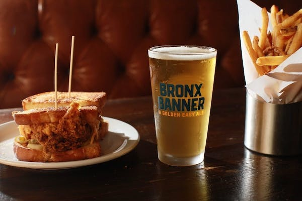 Fried chicken sandwich and beer