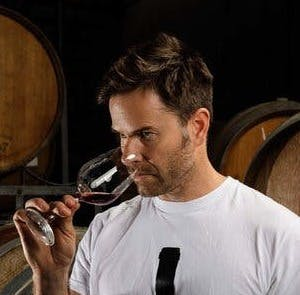 a man holding a wine glass