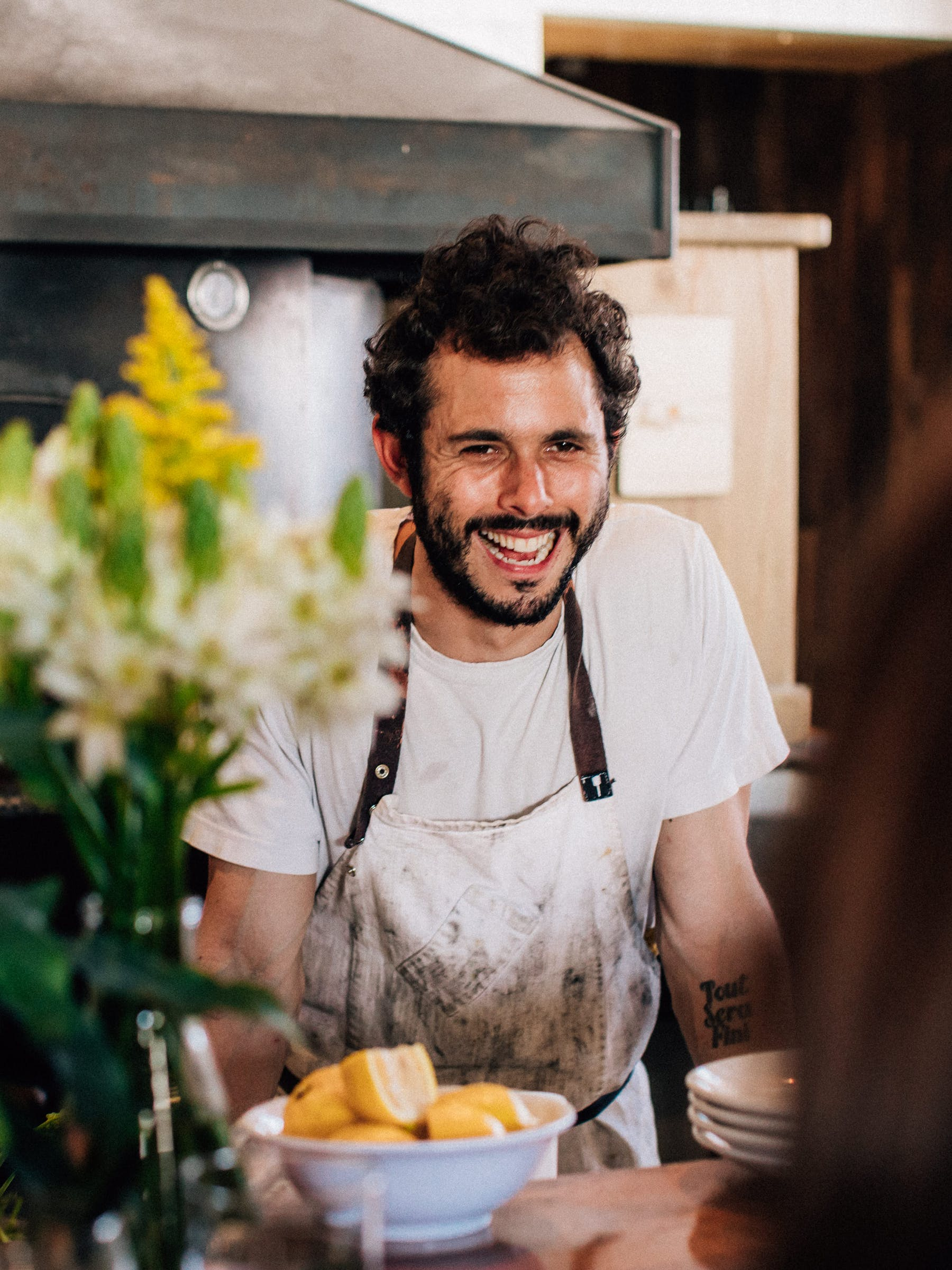 A close up of Chef Ari Taymor smiling at a counter