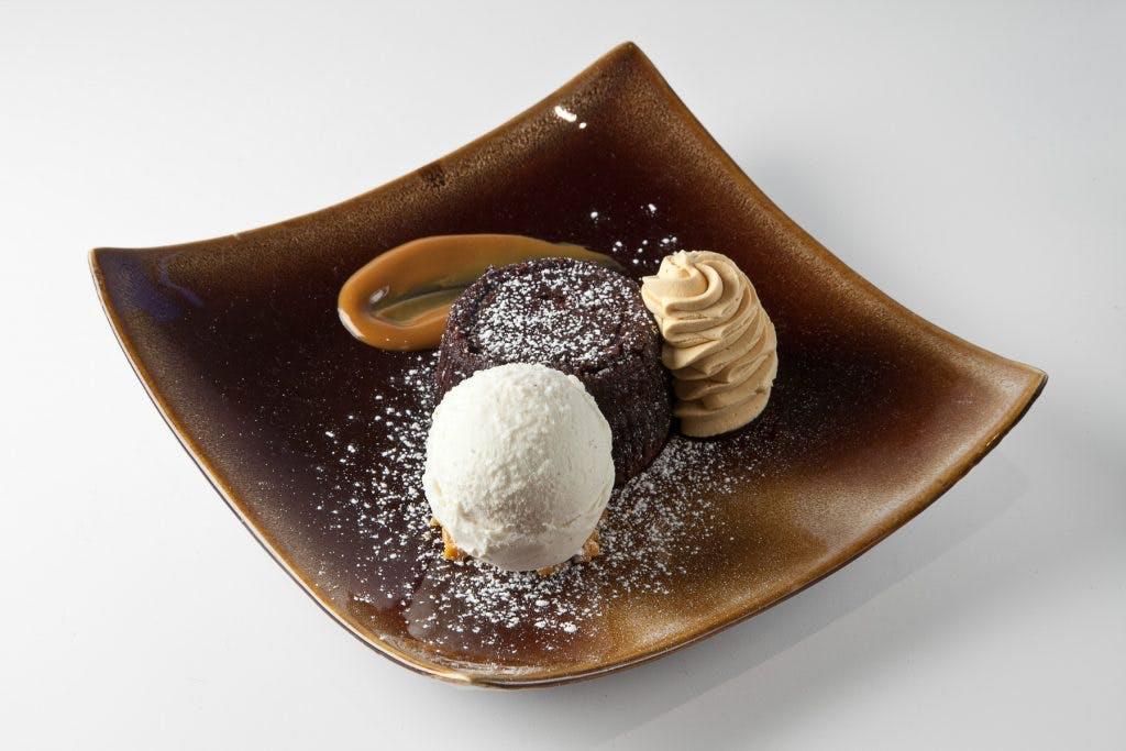 a chocolate doughnut on a plate