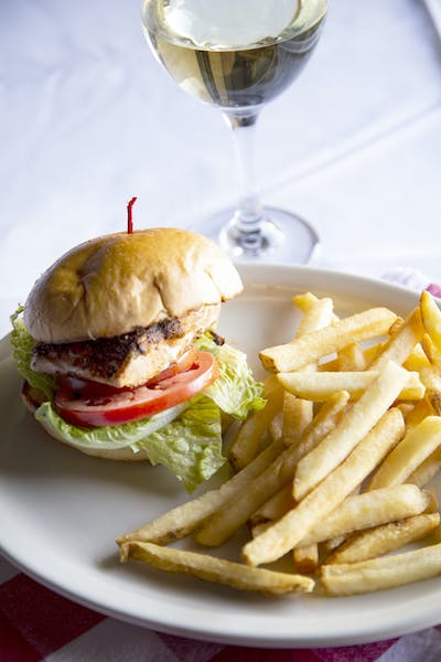 a close up of a sandwich and fries on a plate