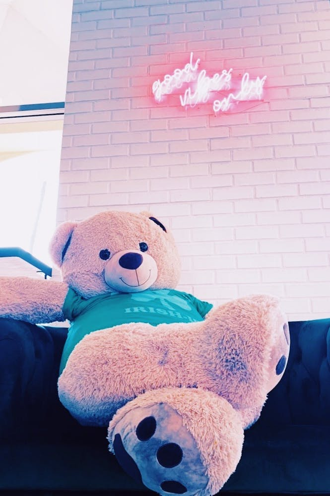 a blue teddy bear sitting on top of a stuffed animal