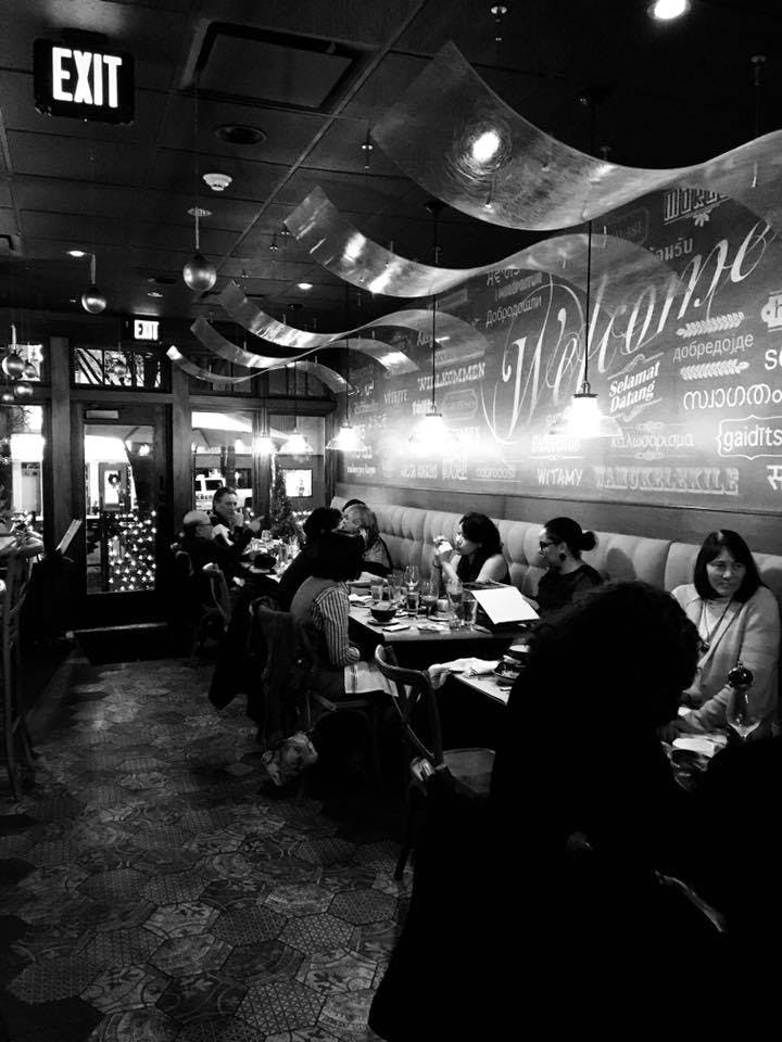 a group of people in a restaurant