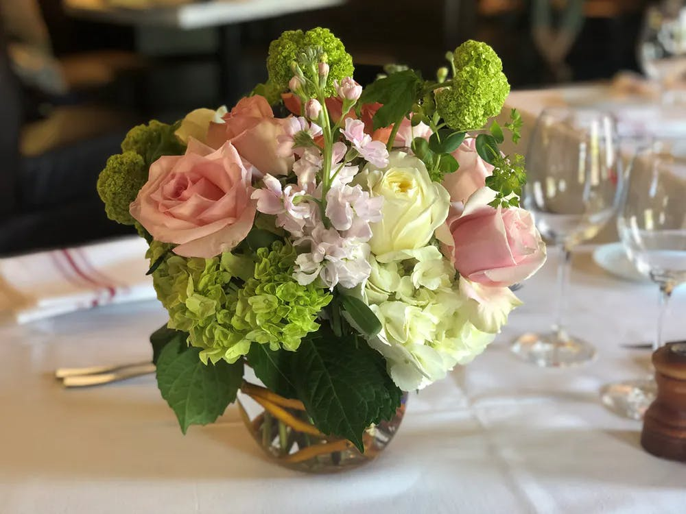 a bouquet of flowers in a vase on a table