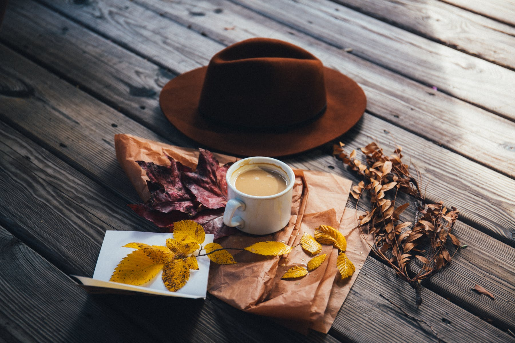 a close up of a hat and a cup of coffee