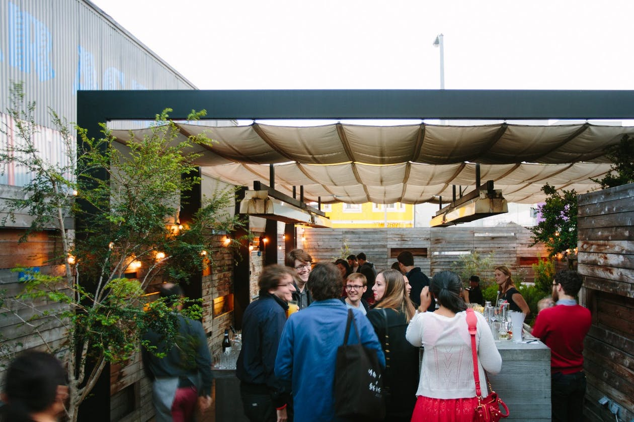The lively outdoor bar scene at Bar Agricole.