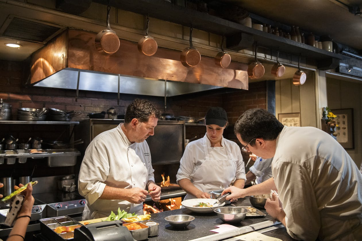 A group of chefs working in the kitchen