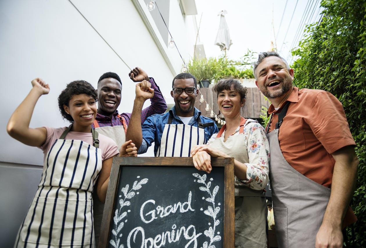 Restaurant staff celebrating a new restaurant opening