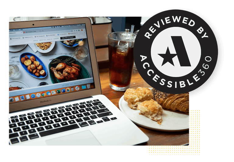 a certified accessible website on a table with a plate of pastries