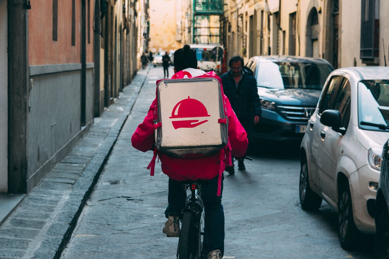 a delivery person on a bike.