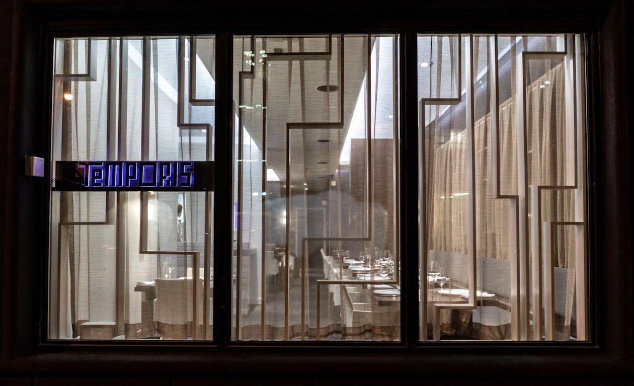 a glass door next to a window