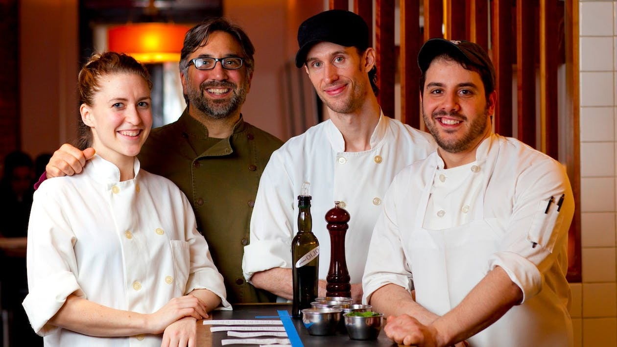 Chef Marco Canora (center, left) with his team.