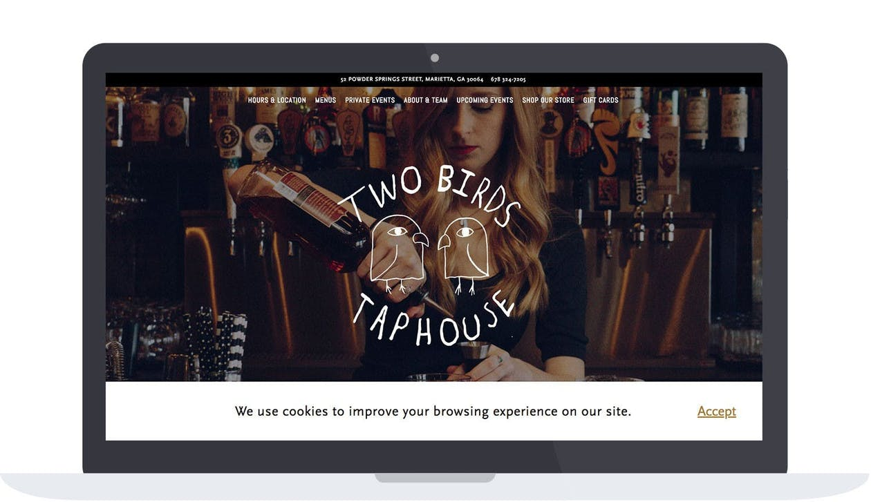 Two Birds Taphouse utilizing a cookie consent alert to inform customers about the way their data is being collected.