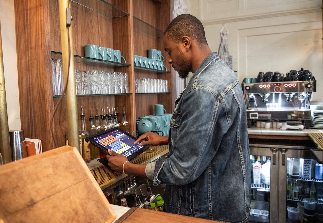 a photo of a main putting in an online order into a pos system