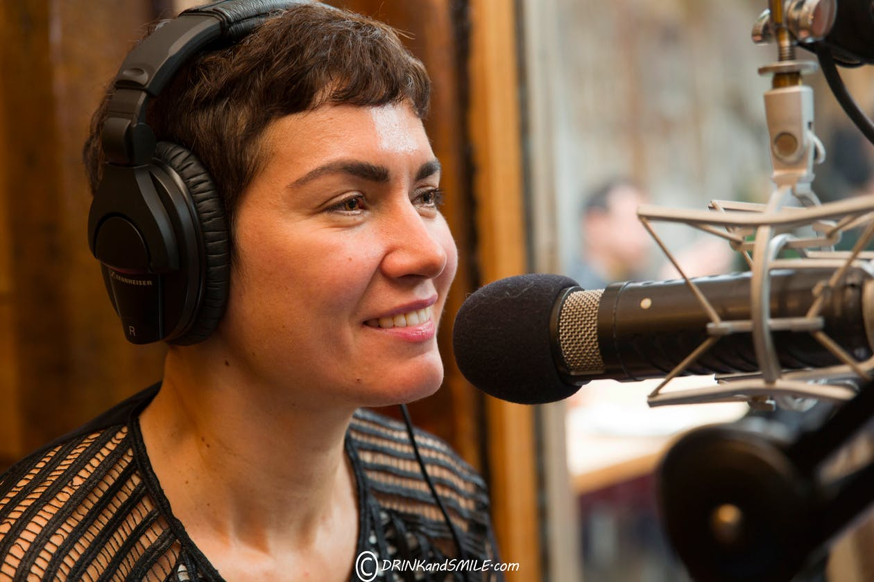 Jennifer Leuzzi talking into a microphone.