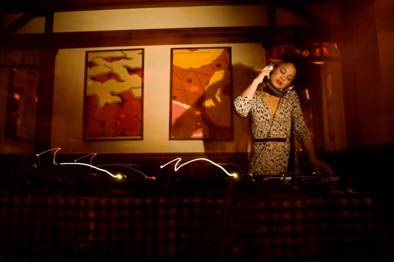 A DJ spinning music in a dark room.