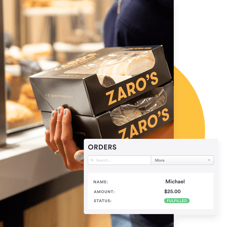 customer holding zaros to-go boxes