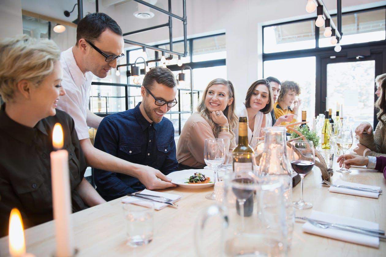 nilperi şahinkaya et al. sitting at a table with wine glasses