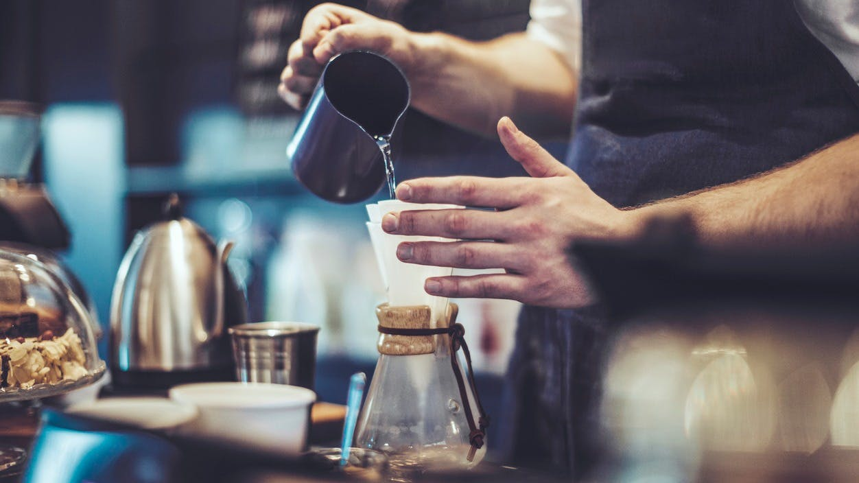 a person pouring coffee