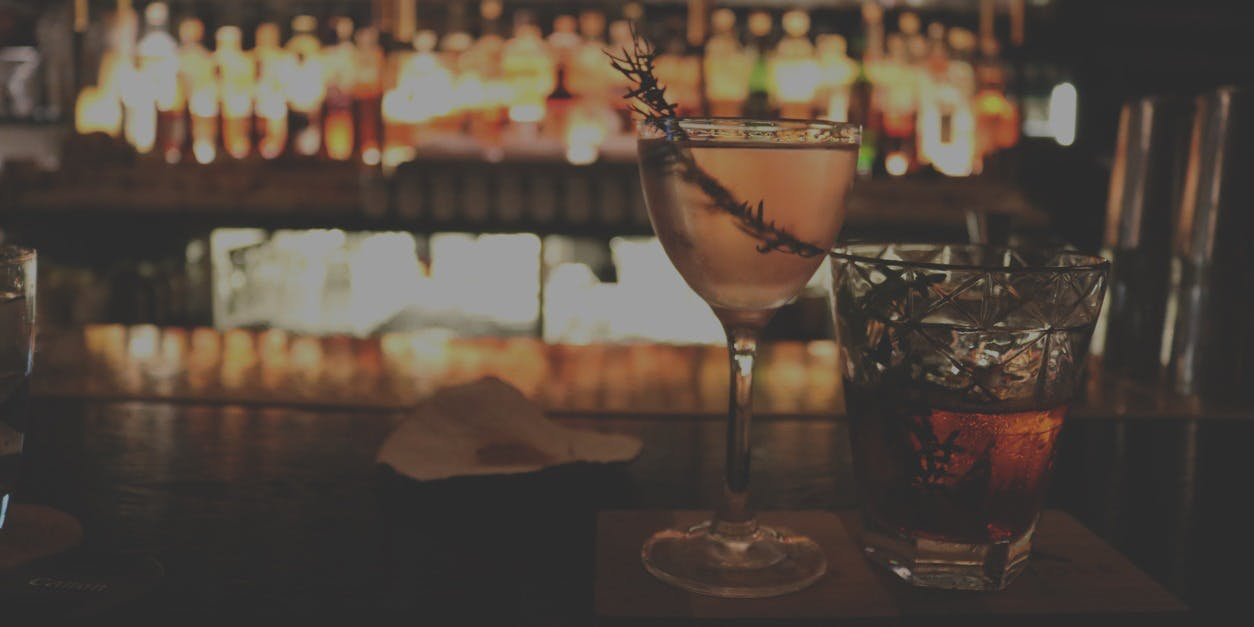 a photo of cocktails on a bar