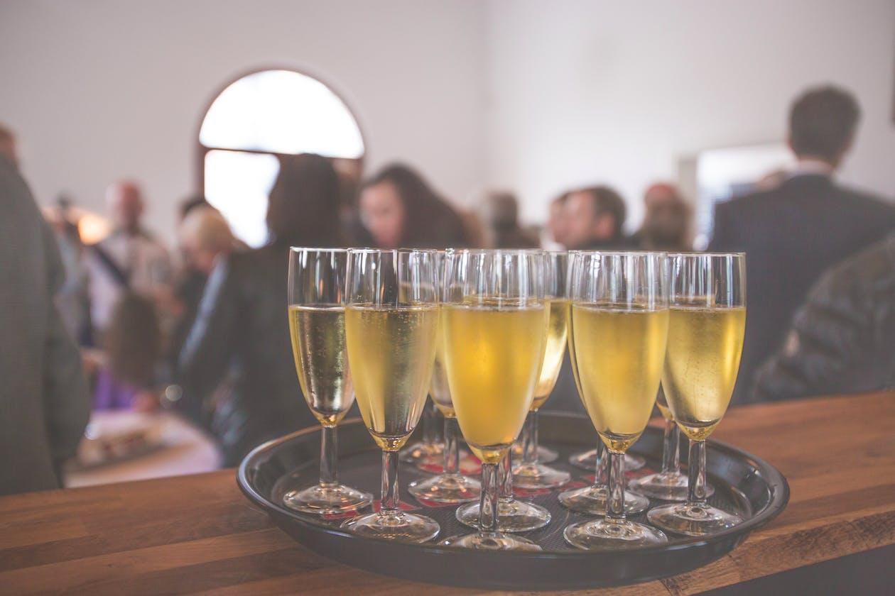 A plate full of wine glasses.