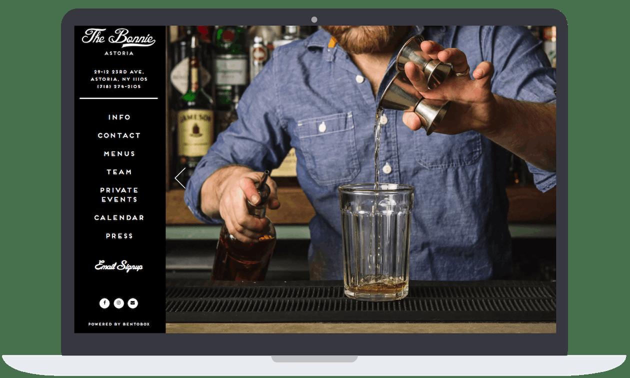 A bartender making a drinking at a bar.