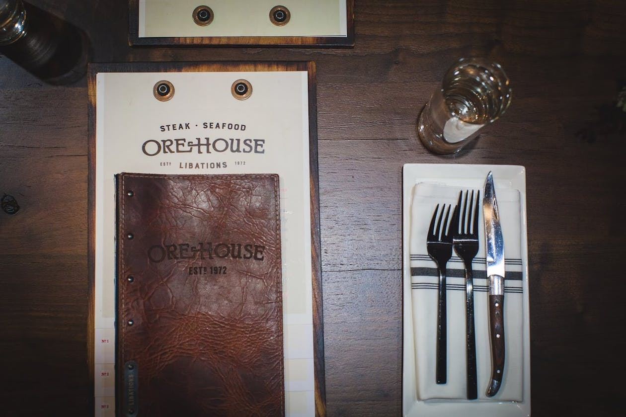 Ore House's printed menus next to table setting