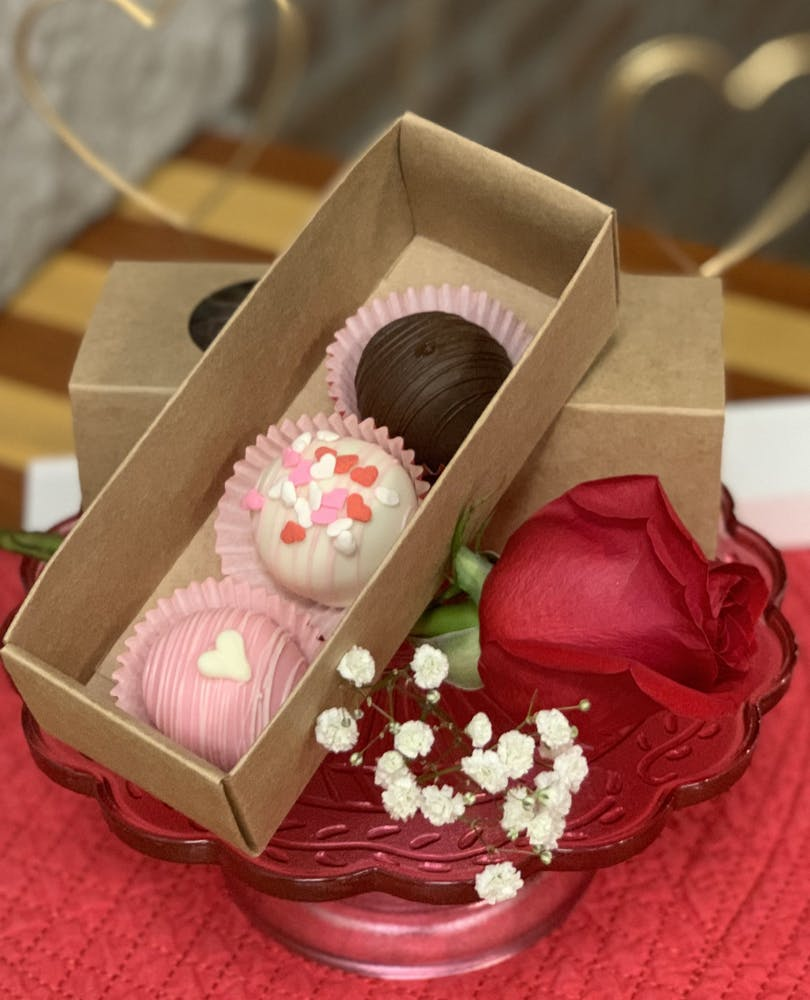 a pink box filled with cake