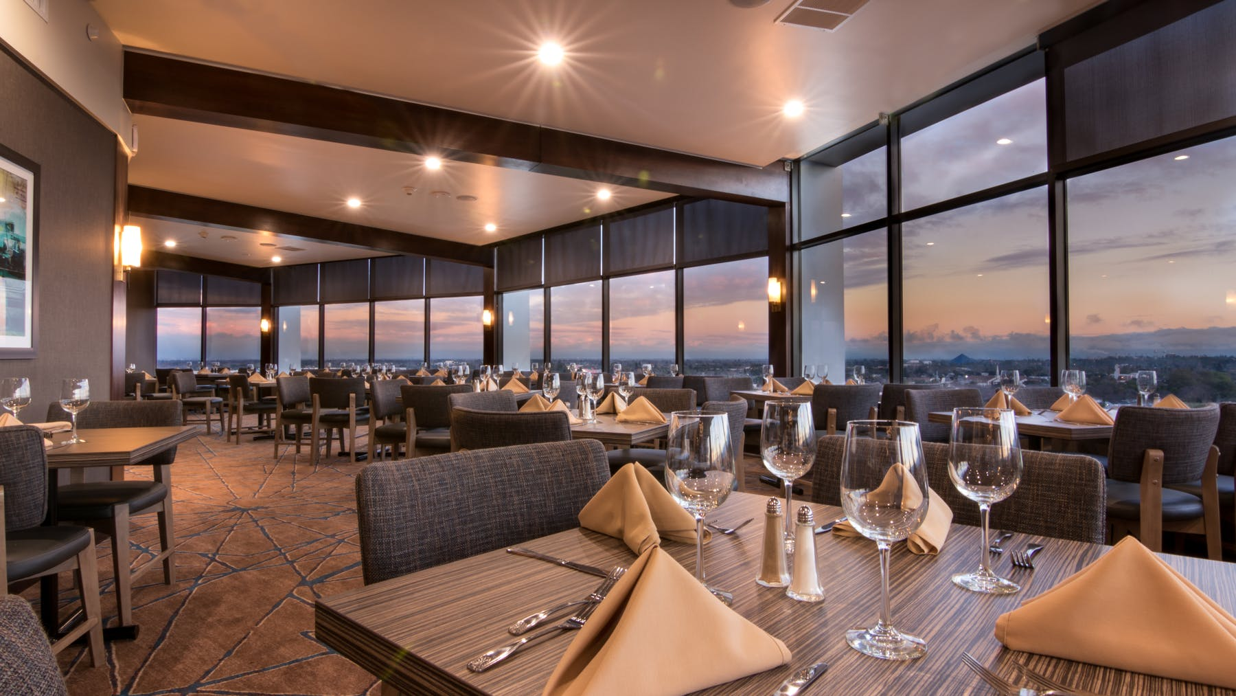 a dining room table with a view to the city