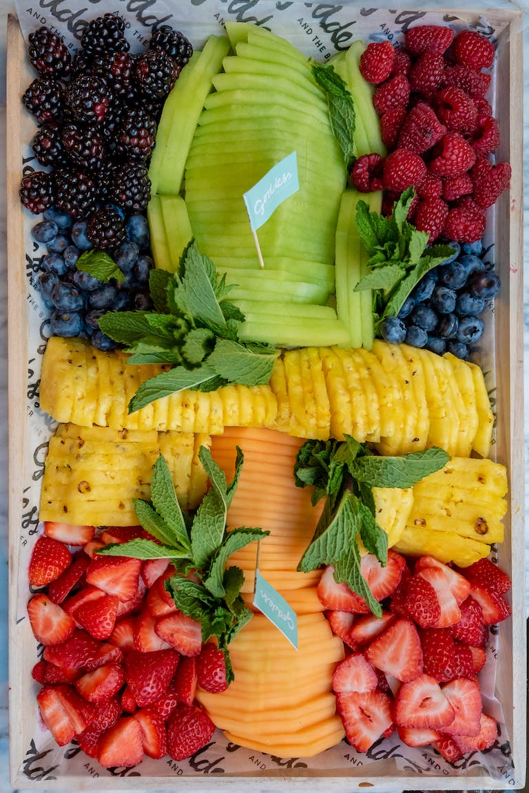 a box filled with fresh fruit and vegetables