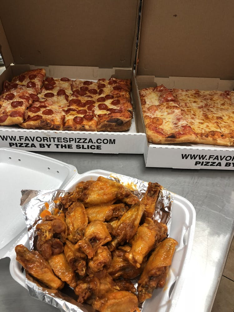 a box filled with different types of pizza sitting on top of a table