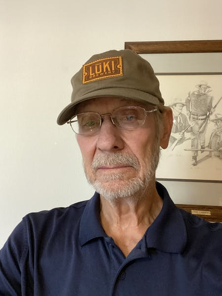 a man wearing a hat and glasses