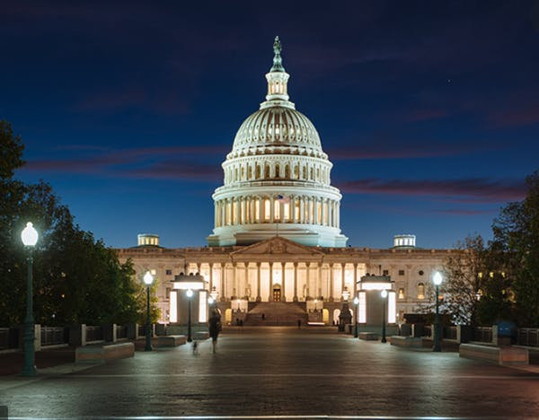 a large building with United States Capitol in the background