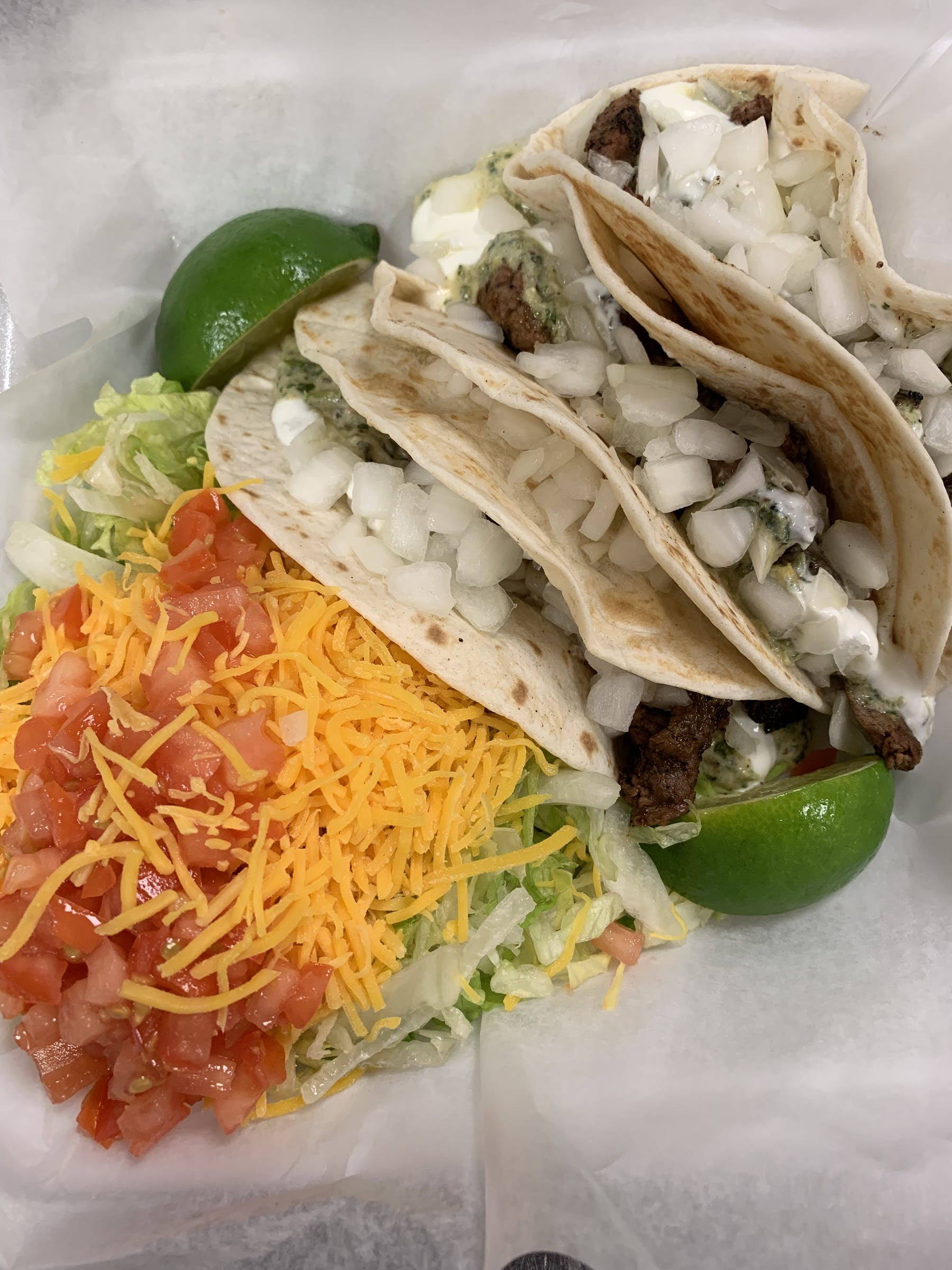 a close up of a plate of tacos