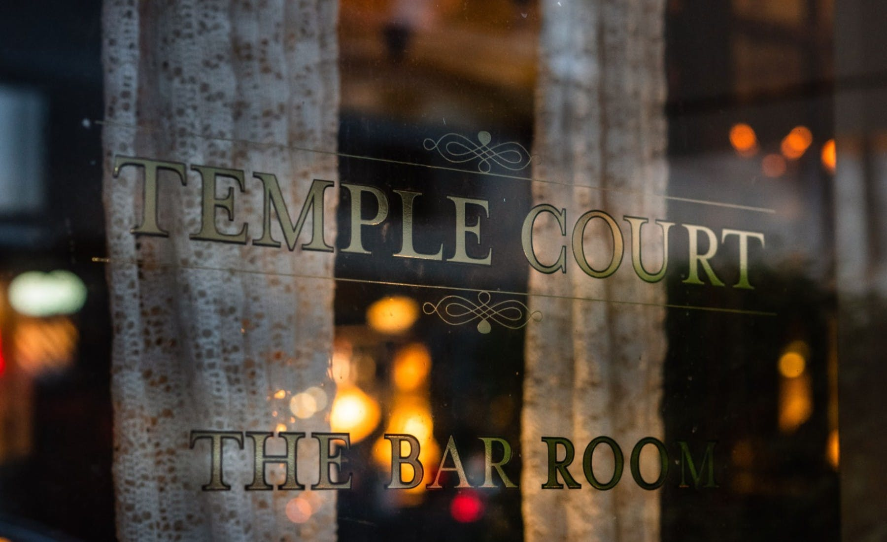 the Temple Court sign on the window