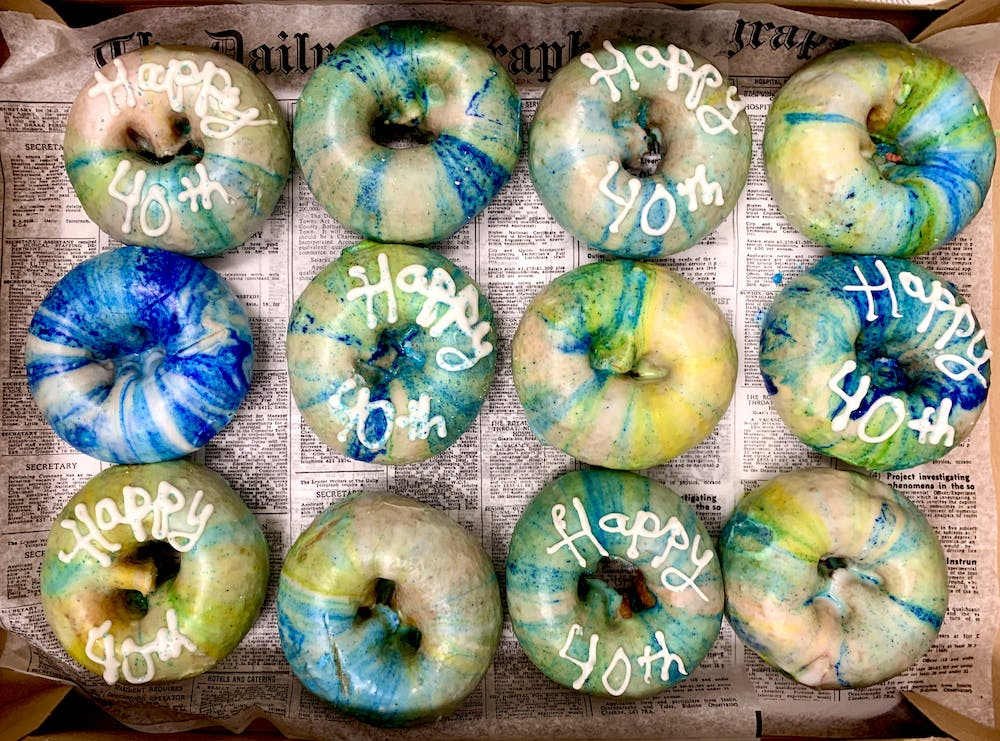 a group of different colored doughnut