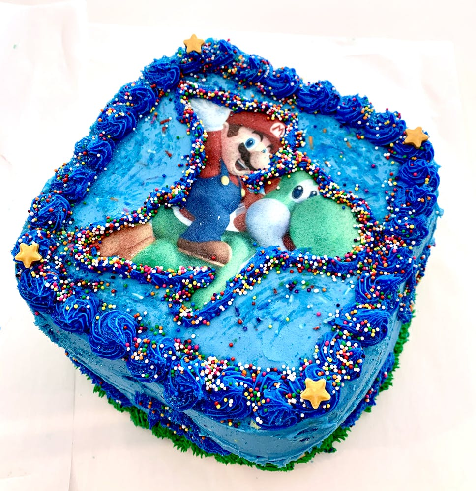 a blue and white cake on a table