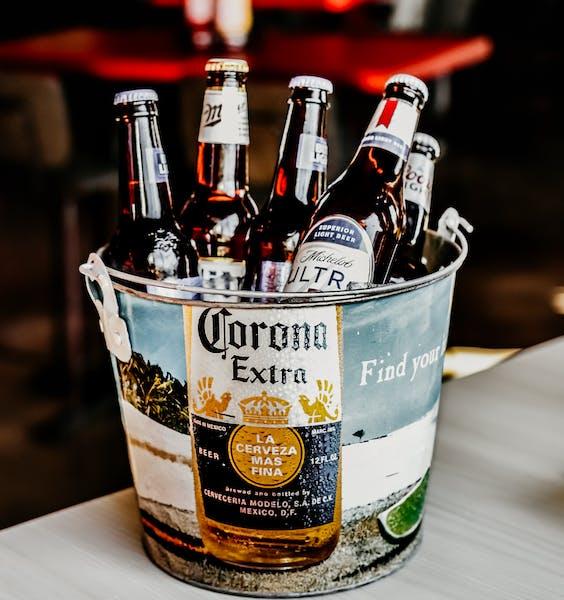 a close up of a Corona beer bucket