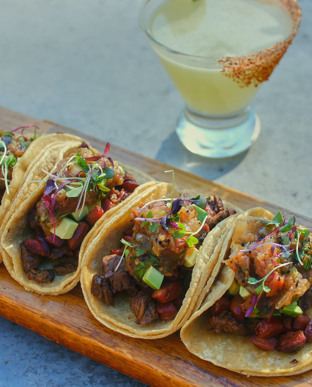 a close up of tacos on top of a table