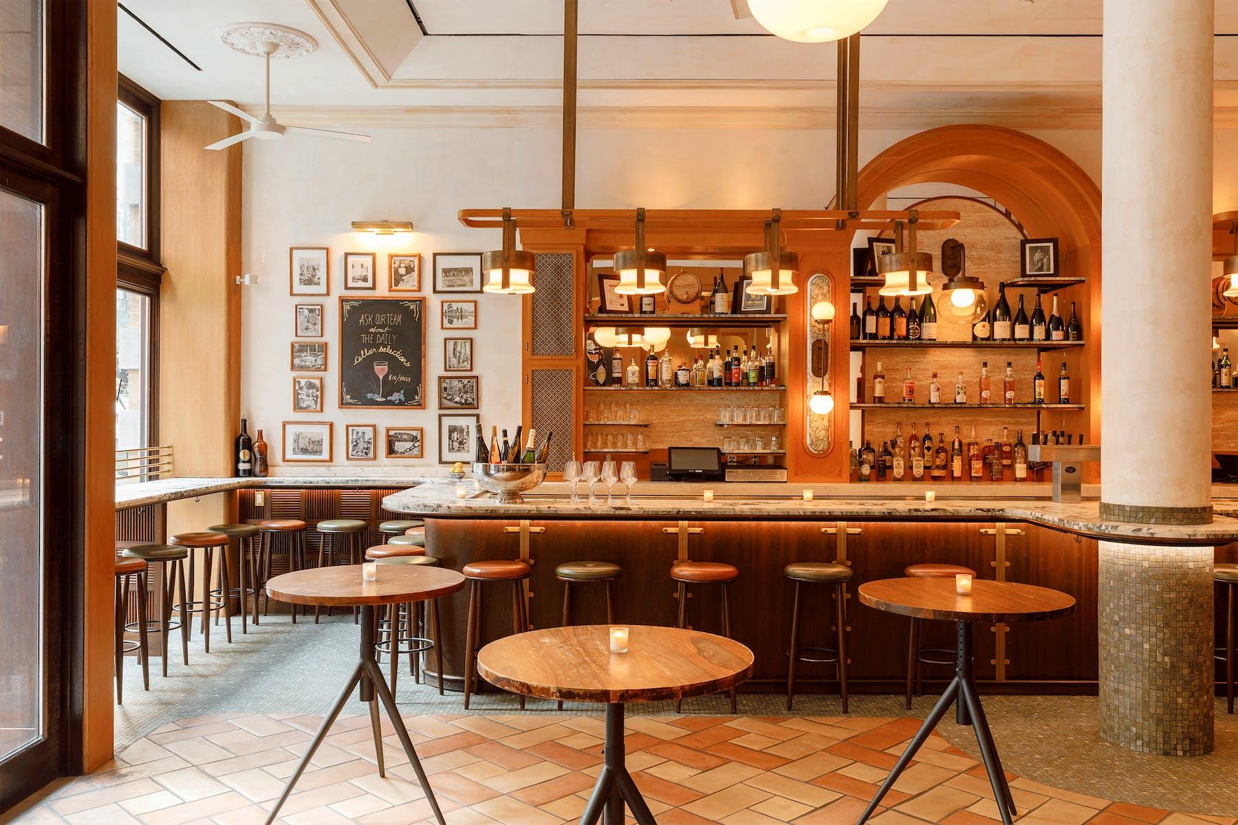 High top tables surrounding the Vini e Fritti bar