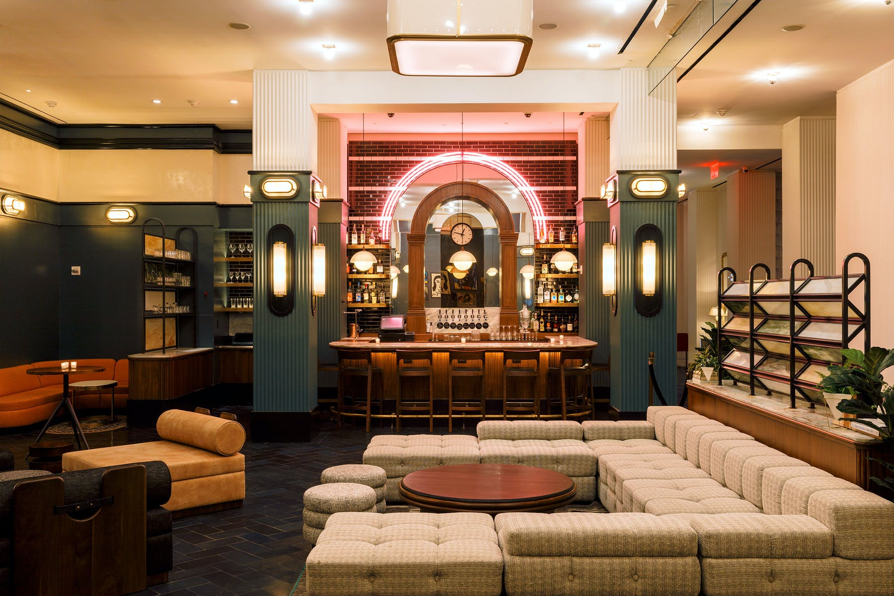 The Lounge at The Redbury Hotel filled with couches and a bar