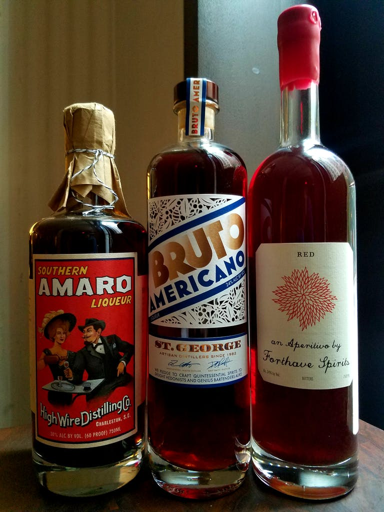 a three pack of amaro and spirits