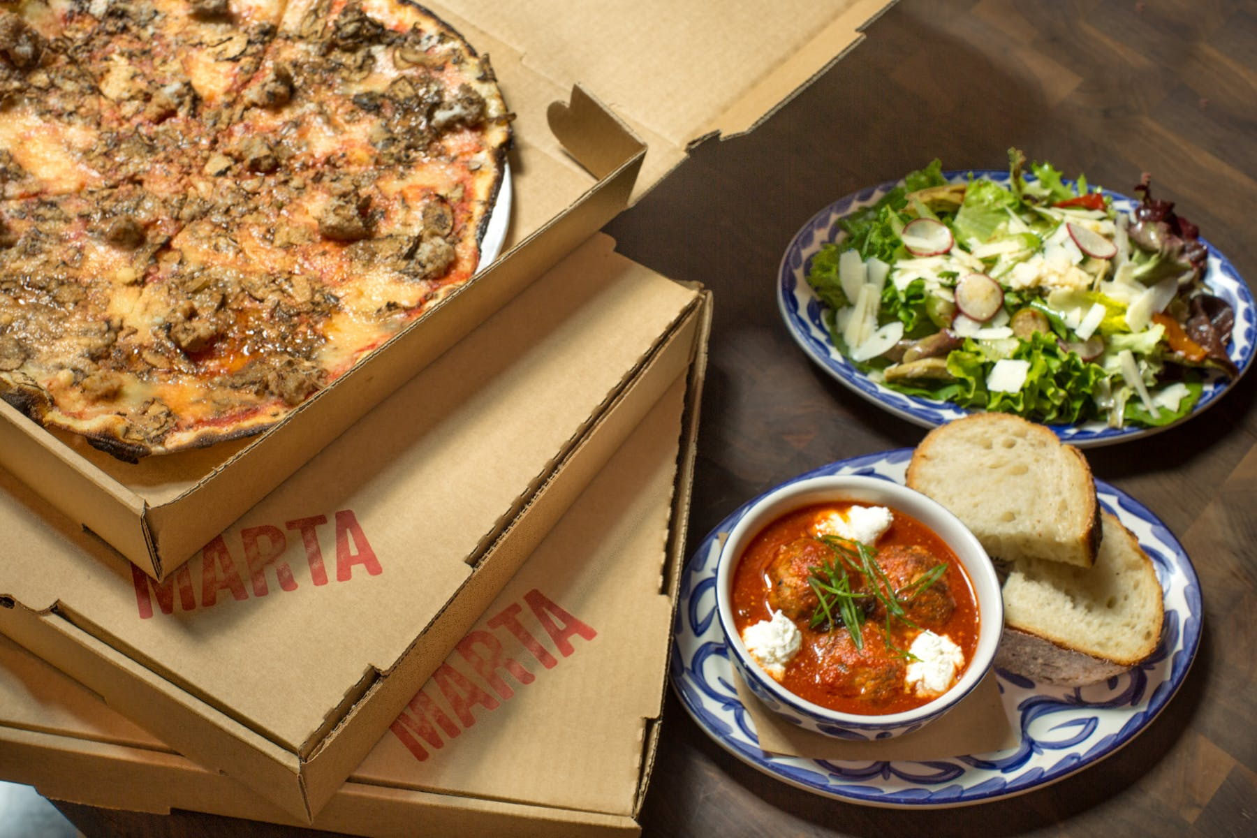 Boxes of Marta pizzas on a table