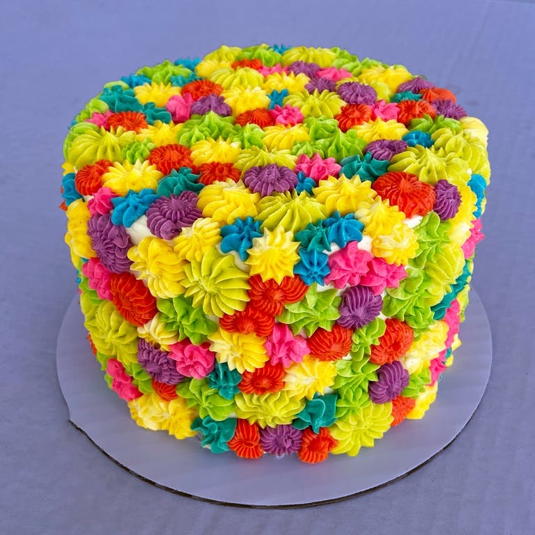 a cake with a colorful hat