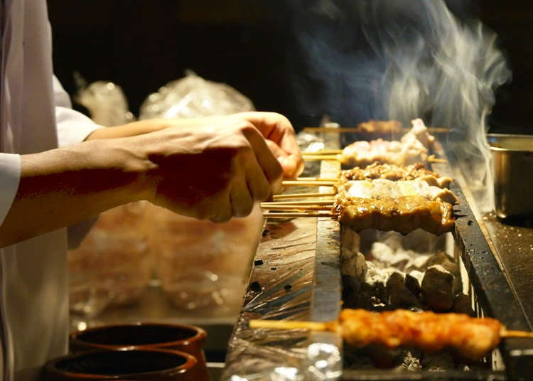 a person cooking food on a table