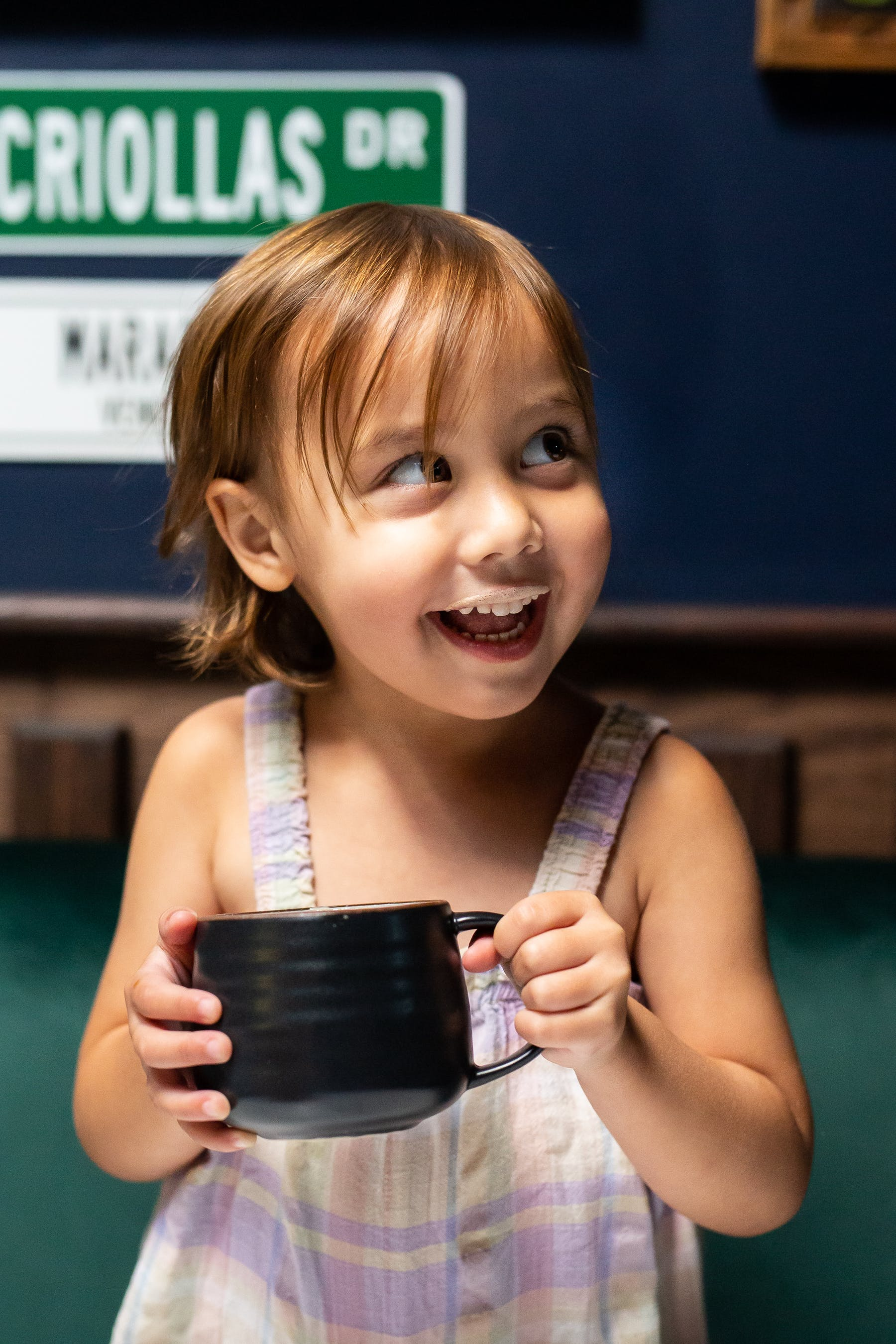 a little girl holding a cell phone