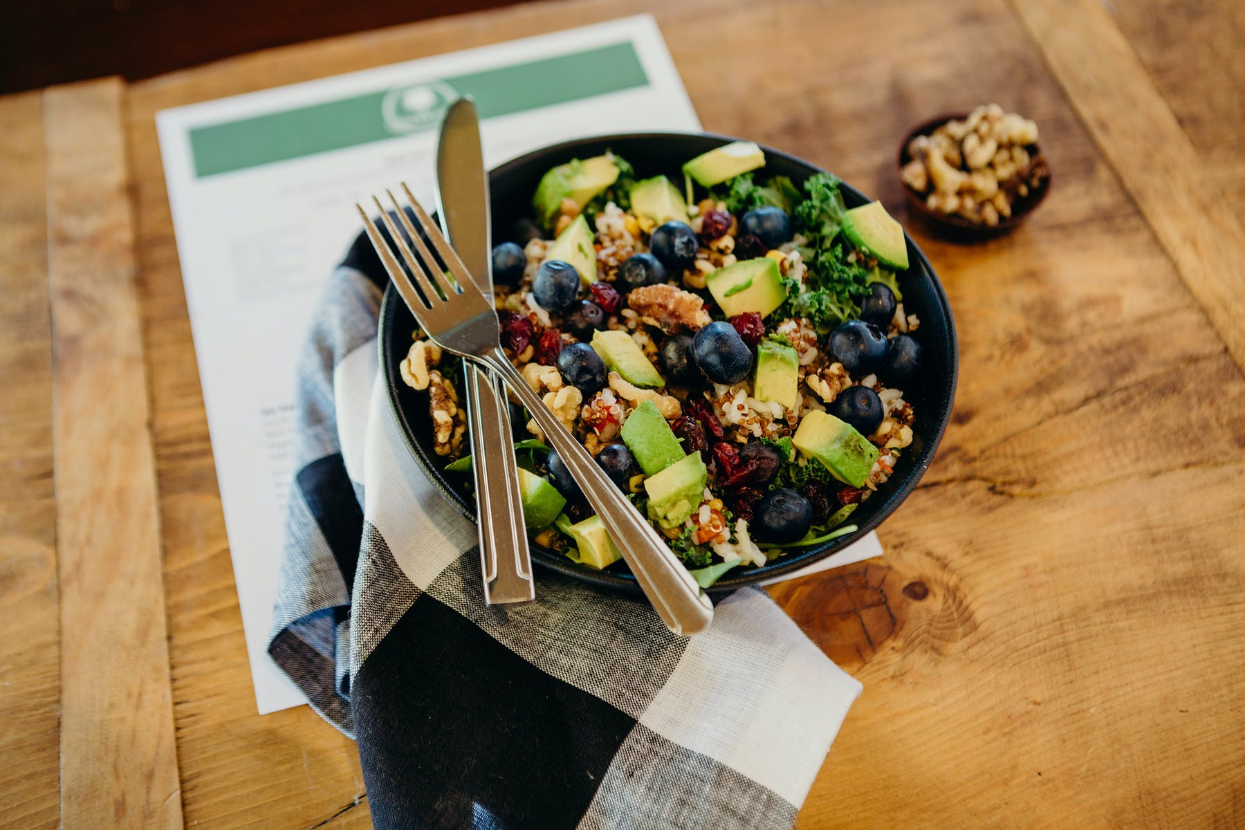 fresh salad with avocado and blueberries