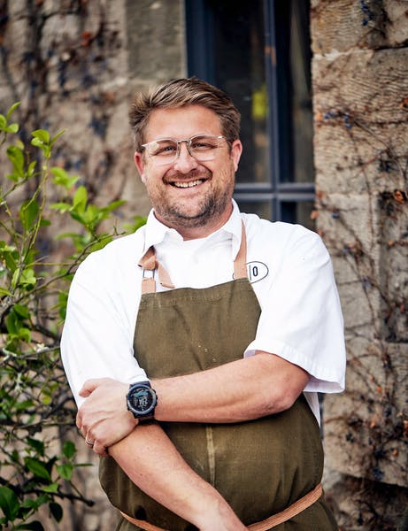 chef curtis di fede standing in front of a charter oak building