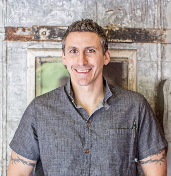 headshot of chef in grey collared shirt
